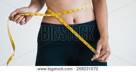 Close Up Shot Woman With Slim Body Measuring Torso