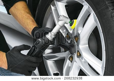 Car Polish Wax Worker Hands Polishing Car Wheel. Buffing And Polishing Car Disk. Car Detailing. Man