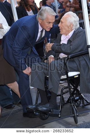 LOS ANGELES - NOV 06:  Michael Douglas and Kirk Douglas arrives to the Walk of Fame honor Michael Douglas  on November 6, 2018 in Hollywood, CA