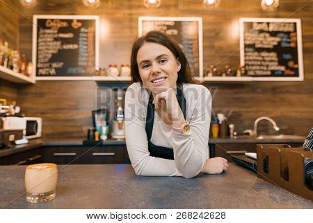 Portrait Of Smiling Young Female Coffee Shop Owner, Confident Woman Standing At The Counter.
