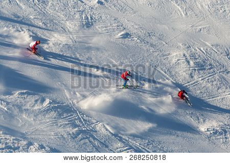 Ski School Aerial View. Downhill Skiing. Skiers In Mountains