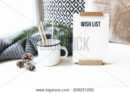 Winter Desktop Still Life Scene. Wish List Card, Board And Wooden Pencils In Mug Standing Near Windo