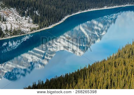 The Reflection Of Canadian Rocky Mountain On Turquoise Peyto Lake At Banff National Park In Alberta,