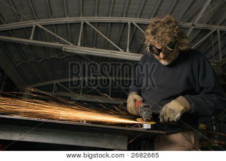 Metalsmith Creating Sparks.