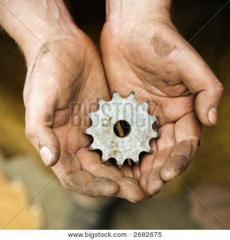 Metalsmith Holding Metal Leaf.
