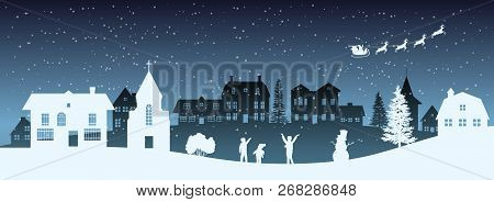 Christmas Nigh Panorama. Silhouettes Of Kids Looking At Santas Sleigh. Celebration Scene. Paper Vill