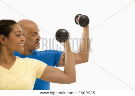 Woman And Man Exercising.