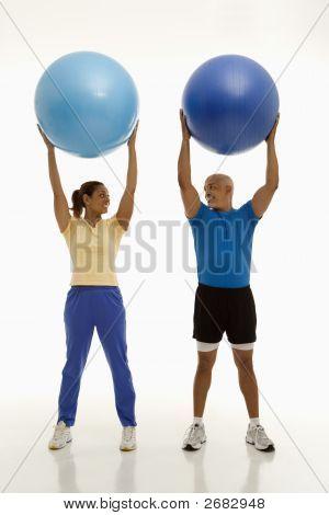 Man And Woman Exercising.