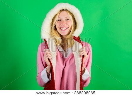 Girl Cheerful Blonde Warming Up Wear Fur Hood On Green Background. Woman Emotional Face Posing In Wa