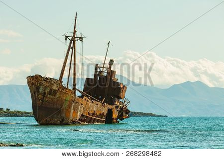 Greek Coastline With The Famous Rusty Shipwreck Dimitrios In Glyfada Beach Near Gytheio, Gythio Laco