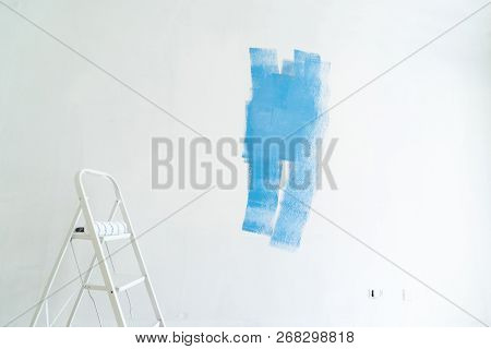 home renovation concept - old flat during restoration or refurbishment with blue paint stains poster