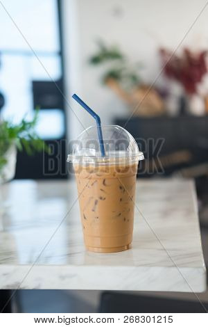 Iced Coffee Mocha In Takeaway Cup On White Table