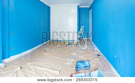 home renovation concept - old room during restoration or refurbishment with newly painted blue walls poster