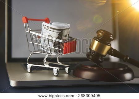 Wooden Gavel On A White Computer Keyboard Conceptual Of Online Auctions Or Law Enforcement And Justi