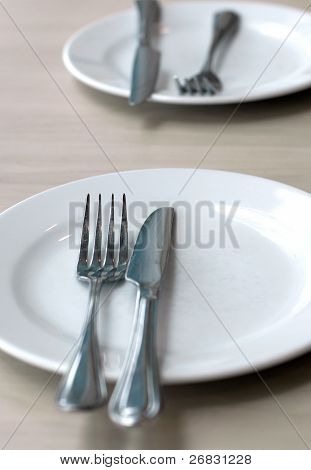 Empty Plate, Spoon And Table-knife