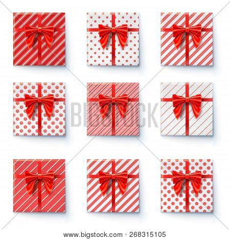 Present Boxes With Red Ribbon And Big Bow Isolated On White Background. Top View On Gift Boxes, Fest