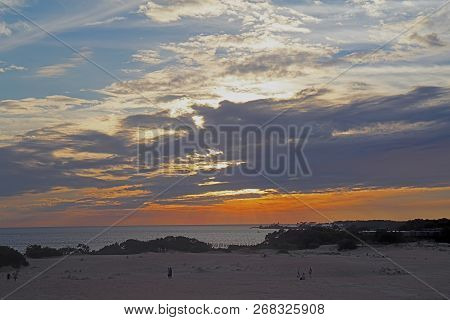 Sunset Over Albemarle Sound As Viewed By Unidentifiable People From Jockeys Ridge State Park In The