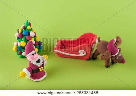 Funny Chrismas And New Year Figures Made Of Colored Modeling Clay. Santa, Deer, Fir Tree, Sleigh On