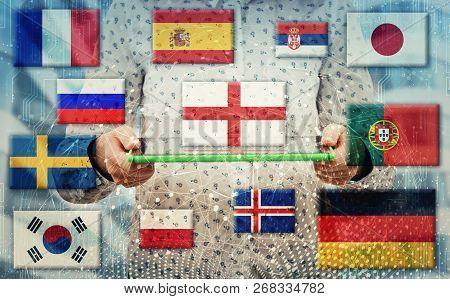 Woman Holding Electronic Tablet As National Flags Show Different Languages Spoken In The World. Lear