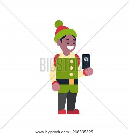 african american man elf santa claus helper hold smartphone merry christmas holiday happy new year c