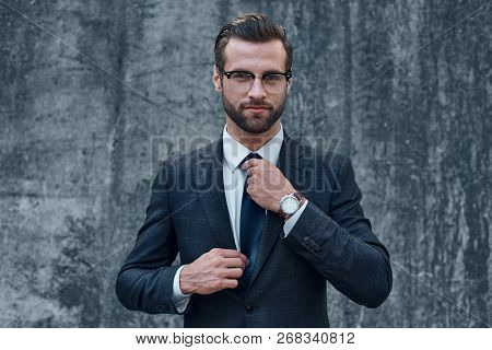Portrait Of A Smiling Handsome Businessman With Arms Folded Over