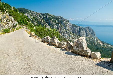 Mountain Asphalt Road On The Top Of Peak Sveti Jure In Front Of Hills And Rocks Of Biokovo Mountain