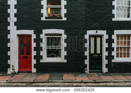 Brighton, England - October 24th, 2018: Classic English Black Facade With Two Doors, In Red And Blac