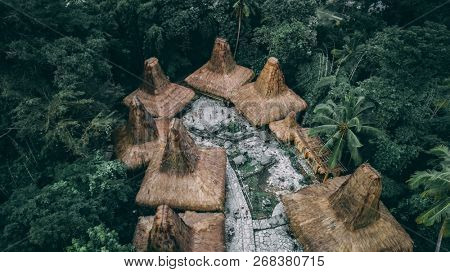 Straw roof huts. Traditional Sumbanese village. Jungle. Cone shape authentic houses