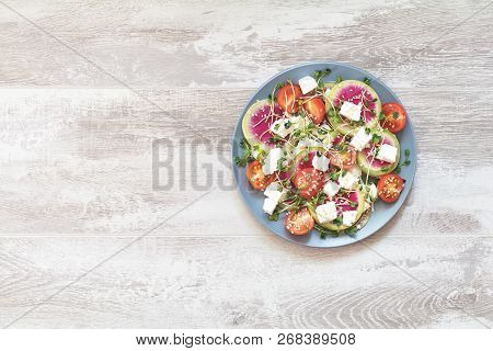 Healthy Delicious Tasty Salad With Tomatoes, Radishes, Cheeses, Sprouts And Sesame In Plate On Light