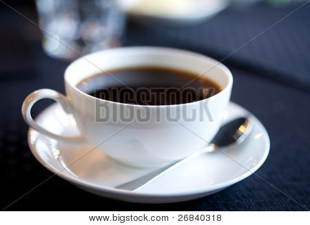 Soft-focused cup of morning black coffee