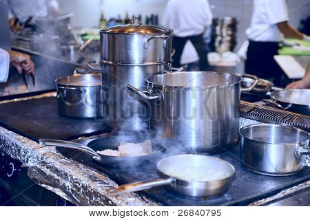 Hot busy kitchen in popular restaurant, toned