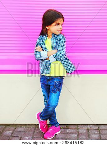 Fashion Little Girl Child Posing On City Street On Colorful Pink Wall Background