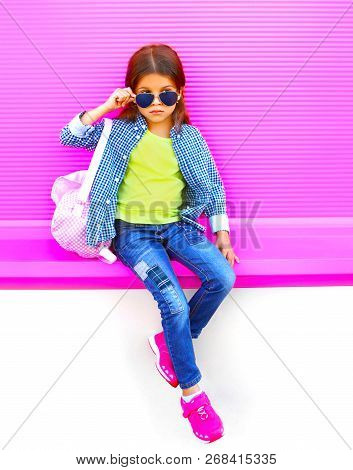 Stylish Little Girl Child On Colorful Pink Wall Background