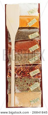 Set of greek spices on wooden plank, isolated