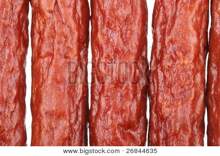 Background of tasty sausages isolated on white