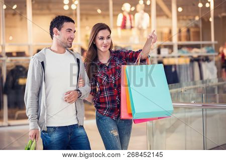 couple shopping center with shopping bags