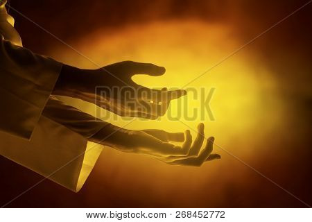 Hands Of Jesus Christ With Open Palm Over Yellow Bright Background