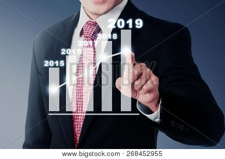 Businessman Raise The Graph On 2019. Happy New Year 2019