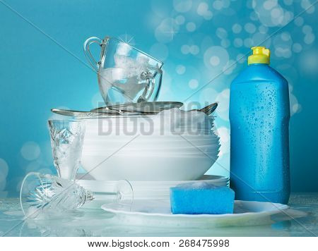The Process Of Dishwashing. Clean Dishes In The Suds And Wash Dishes