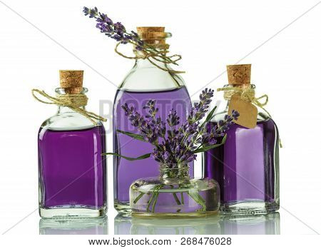 Three Bottles With A Fragrant Tincture Of Lavender And Fresh Twigs Isolated On White Background