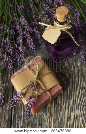 Handmade Soap And Tincture Of Fragrant Lavender On Dark Boards