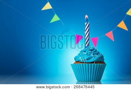 Cupcake Birthday With Candle Beautiful On A Bright Blue Background