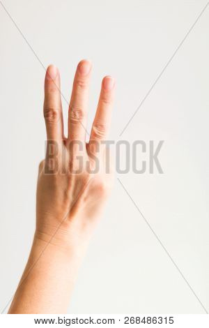 A Hand Showing Three Fingers (index Finger, Middle Finger And Ring Finger) On White Background For S