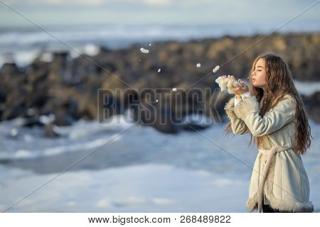 A Young Girl On The Shore Of A Stormy Sea Is Photographed On A Tourist Trip Around Sakhalin Island W