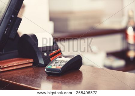 Payment with credit card. Red bankcard inserted in EDC machine poster