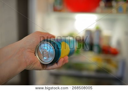 Male Hand Holding Beer From Refrigerator, Close Up