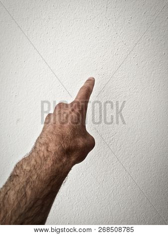 White Man's Finger Shows Direction, Outstretched Palm, Hand On A White Background, Part Of The Body,