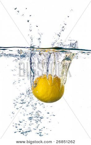 Lemon dropped into water with splash isolated on white