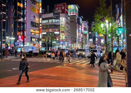 Tokyo, Japan - November 30, 2016: People Walk Under The Neon Lights Of Shinjuku District Of Tokyo, J