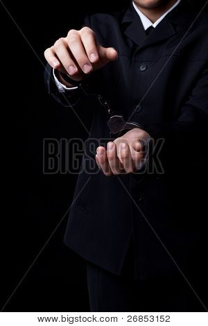 Business man in black suit and handcuffs poster